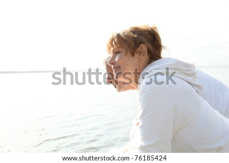 Senior couple in bathrobe standing on a pontoon