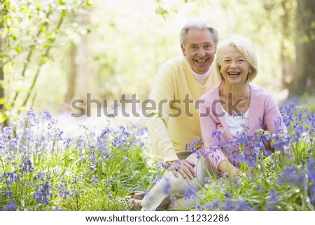 Senior couple in bluebell woods - stock photo