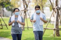 Senior couple in cooper wearing protective mask, Just keep going Stay active, stay well