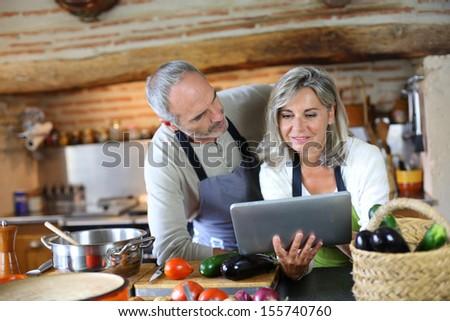 Senior naturist couples