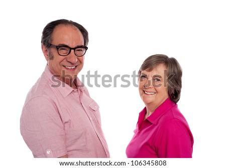 Senior couple. Love birds posing against white background