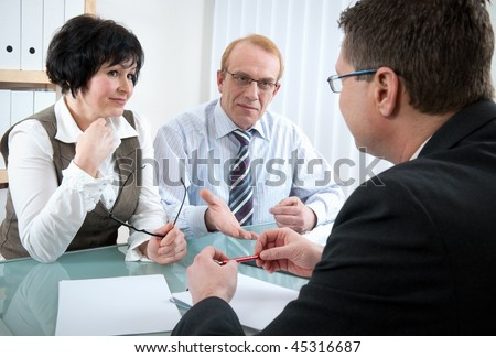 Senior couple meeting with agent