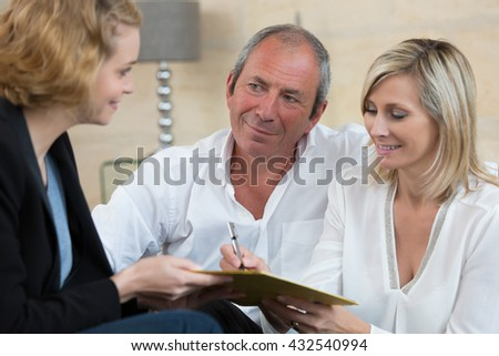 senior couple negotiating with businesswoman for new investment - Shutterstock ID 432540994