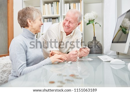 Senior couple of retirees  doing accounting at home Сток-фото ©