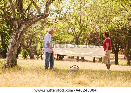Senior couple, old man and woman in park on weekend activity. Grandpa and grandma doing picnic in wood