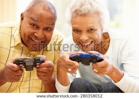 Senior couple playing computer games