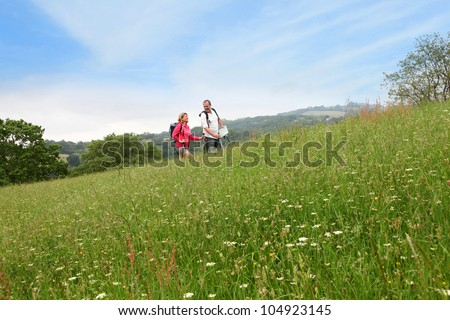Senior couple rambling in countryside