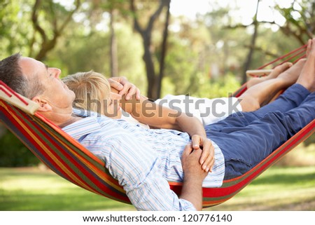 Senior Couple Relaxing In Hammock stock photo