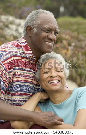 Senior couple relaxing outdoors smiling