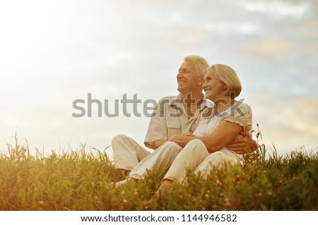 Senior couple resting at summer field