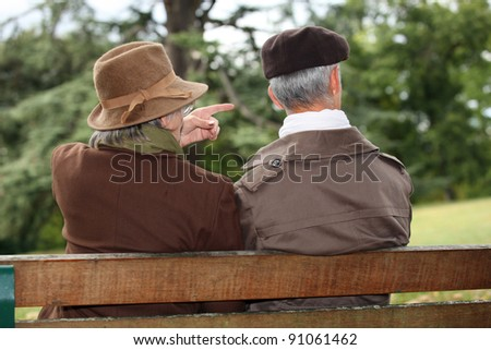 senior couple seated on a park bench