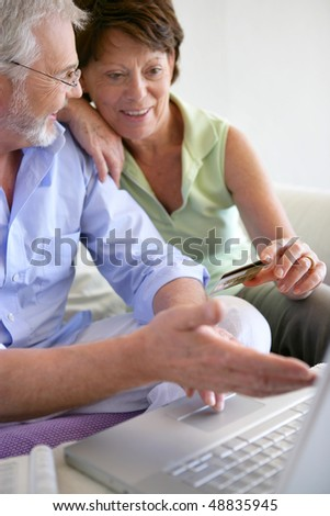 Senior couple shopping on internet