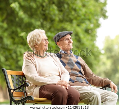 Senior couple sitting on a bench outdoors
