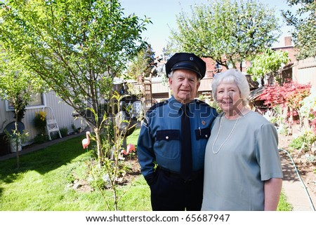 Senior couple standing together in yard