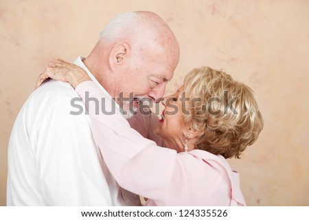 Senior couple still in love and happy after decades of marriage.