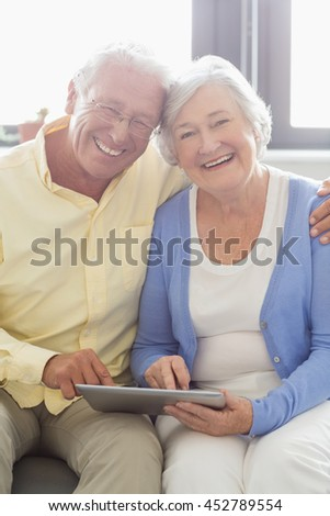 Senior couple using a tablet in a retirement home #452789554