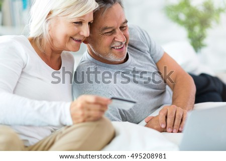Senior couple using laptop #495208981