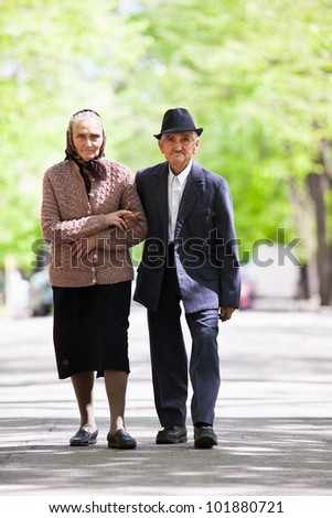 Senior couple walking outdoor in the park