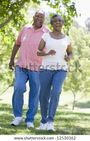 Senior couple walking together outside
