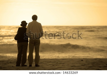 senior couple watching the sunset