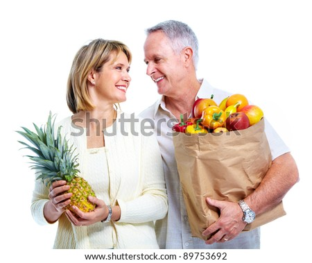 Senior couple with a grocery shopping bag. Isolated on white background.