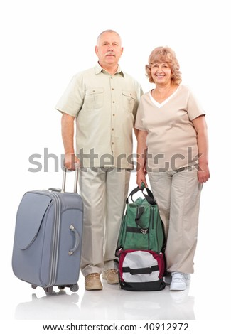 Senior couple with bags. Isolated over white background