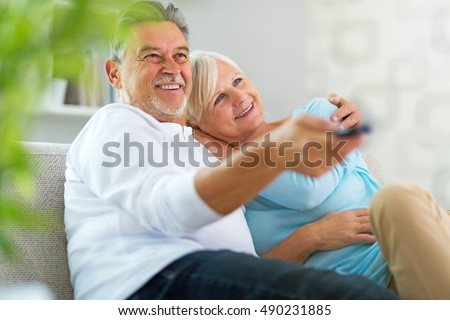 Senior couple with remote control  #490231885