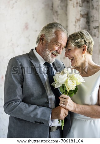 Senior Couple with White Roses Flower Bouquet