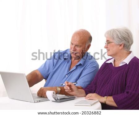 Senior couple working on finances