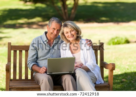 Senior couple working on their laptop
