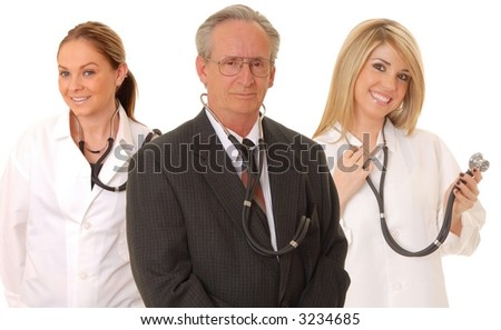Senior doctor physician and two younger medical team members isolated on white