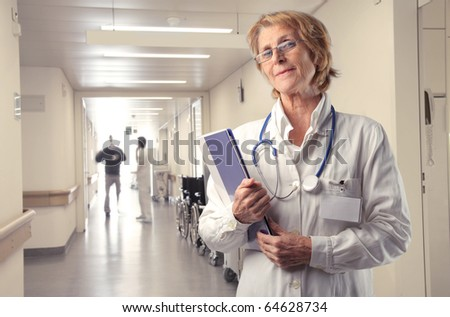 Senior doctor standing in a hospital ward