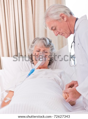Senior doctor with his sick patient - stock photo