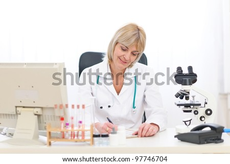 Senior doctor woman working at office