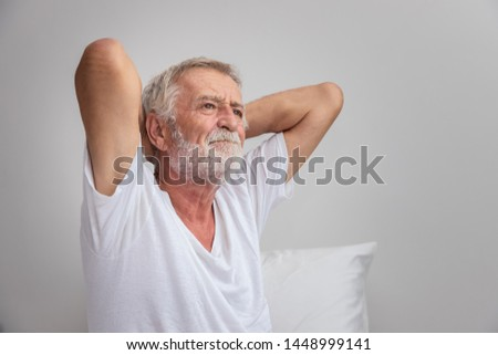 Senior elderly man sitting on bed with depressed after waking up in morning #1448999141