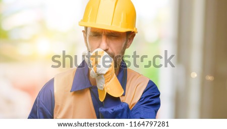 Senior engineer man, construction worker sick and coughing, suffering asthma or bronchitis, medicine concept