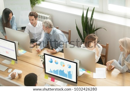 Senior executives teaching young employees in office, diverse corporate workers staff group talking discussing work together, company team people colleagues collaborating, mentoring teamwork concept