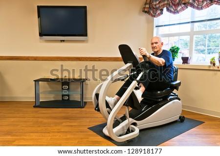 Senior exercising in gym