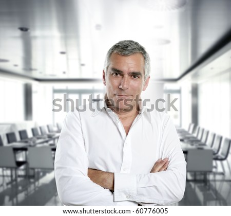 senior expertise gray hair businessman posing interior white modern office [Photo Illustration]