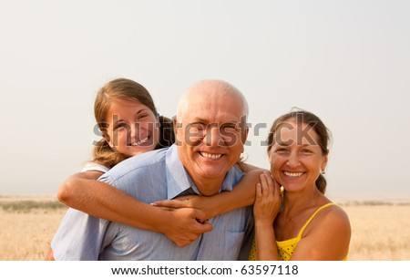 Senior father and mother whith teen daughter outdoor