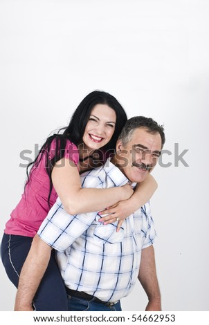 Senior father giving piggyback to her adult daughter and both laughing and having fun,copy space for text message