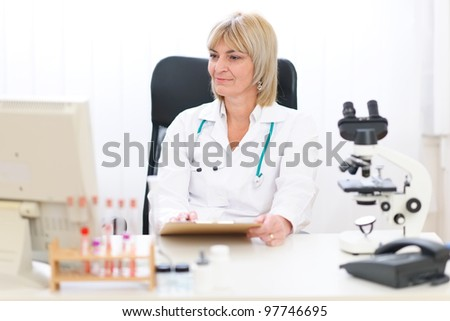 Senior female doctor working at office