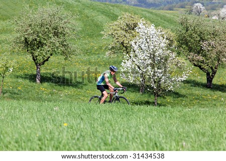 Senior fitness training and goes on a bike racer - stock photo