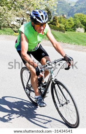 Senior fitness training and goes on a bike racer