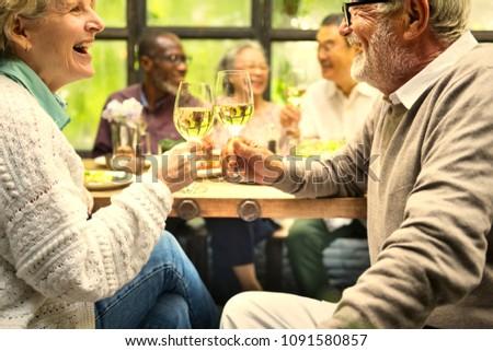 Senior friends having fun at a dinner