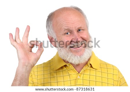 senior funny bald man in yellow shirt shows OK sign
