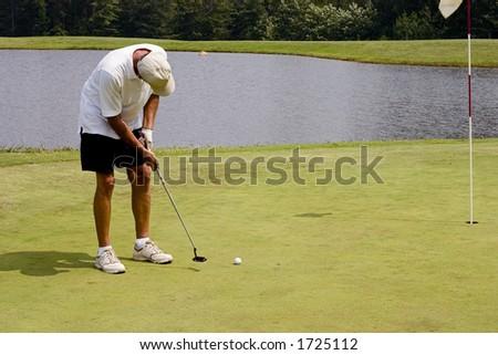 Senior golfer on the green shooting for par