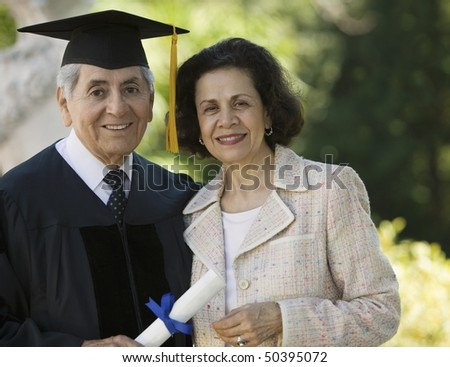 Senior Graduate and Wife outside, portrait
