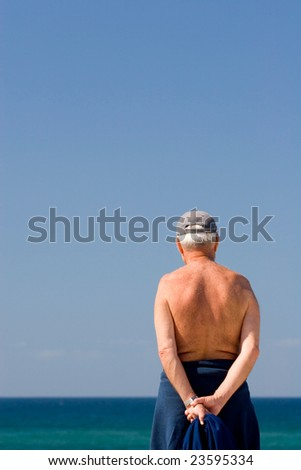 senior grandfather pensioner looking at the future and taking a sun bath