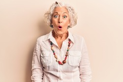 Senior grey-haired woman wearing casual clothes scared and amazed with open mouth for surprise, disbelief face